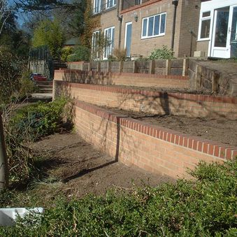 Retaining walls used to construct raised planters in West Runton